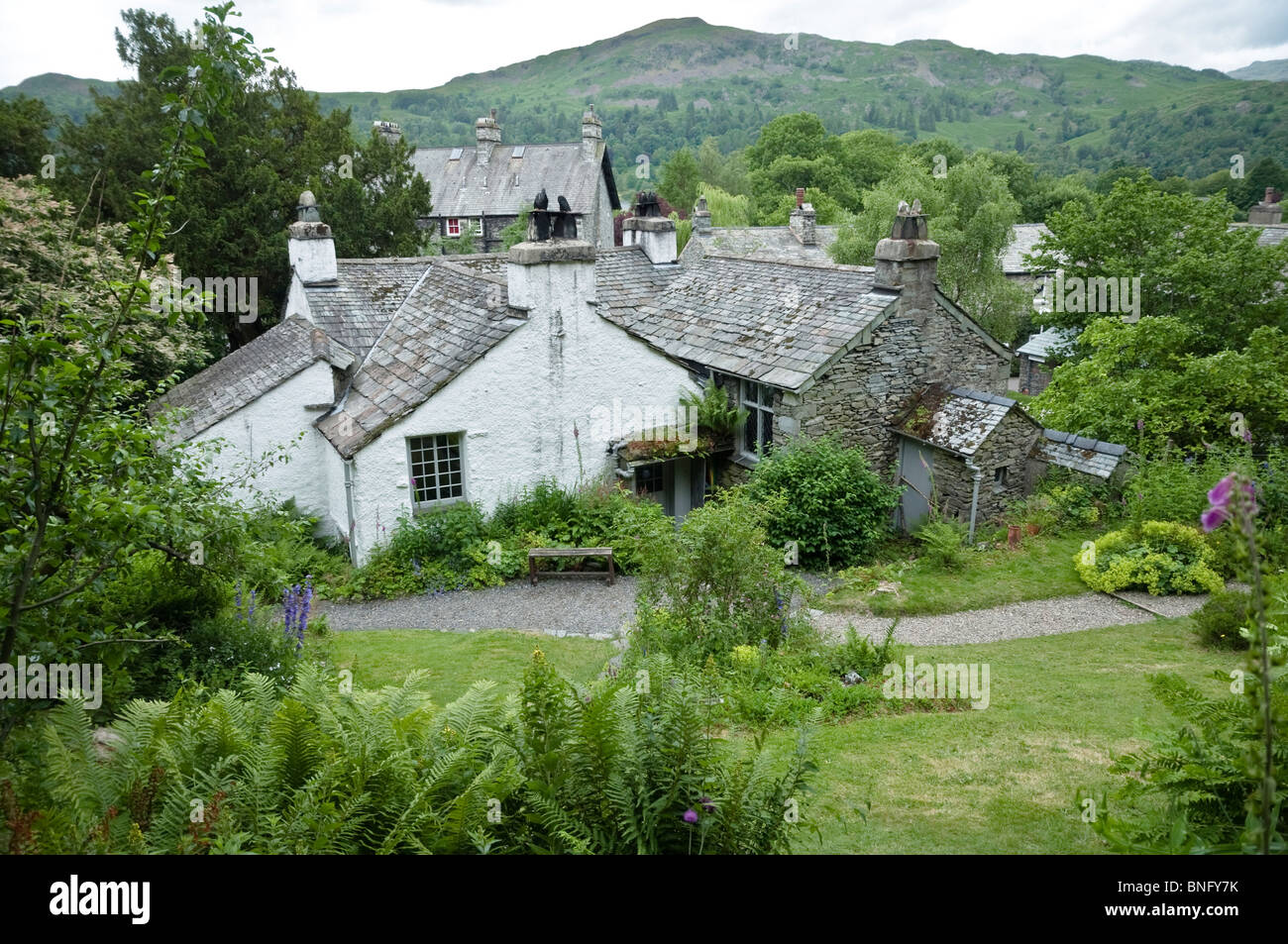 Dove Cottage garden with a view towards Grasmere and Silver Howe fell, - home to William Wordsworth, The Lake District, - Stock Image
