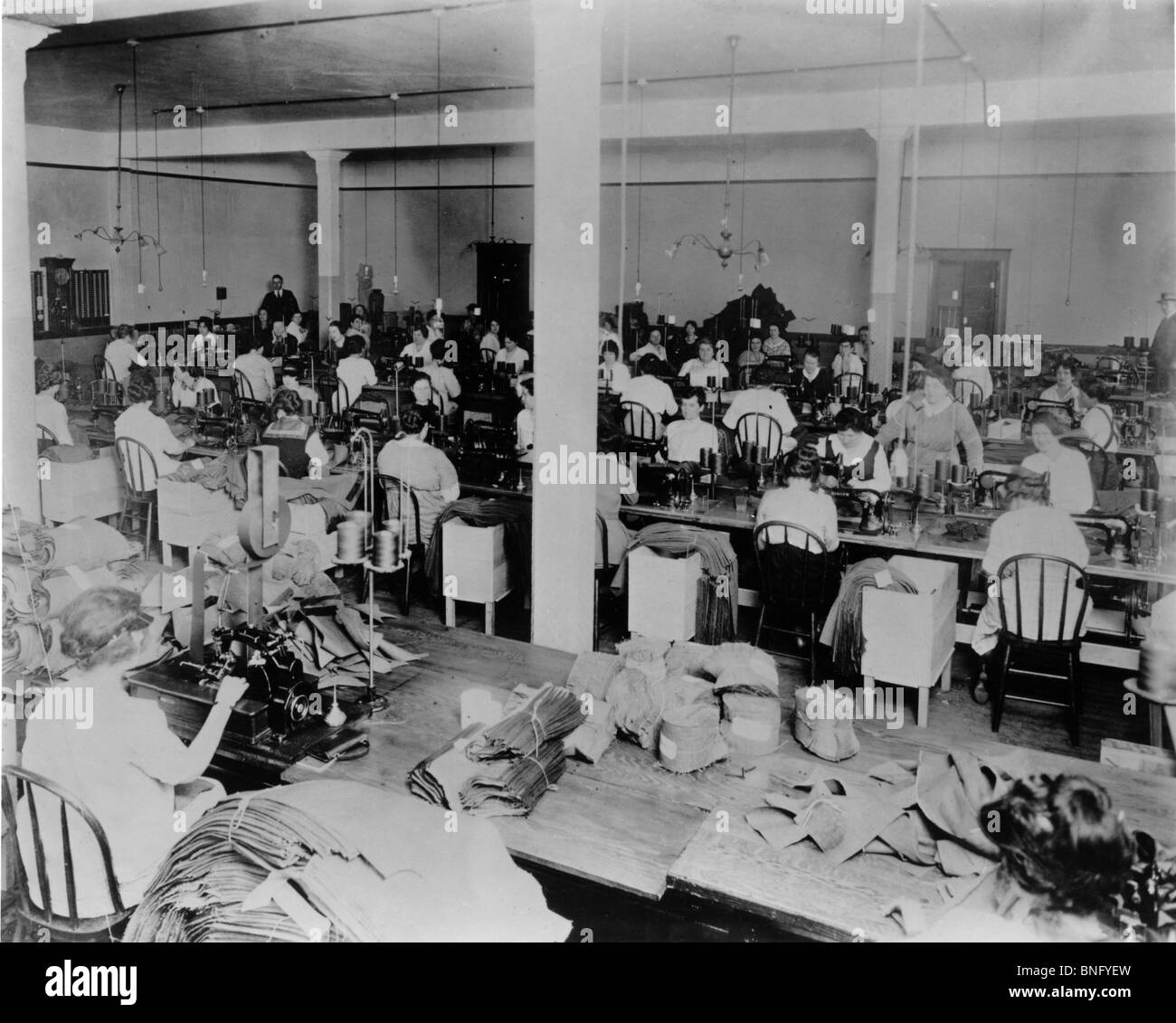 High angle view of a group of female workers in a textile factory - Stock Image