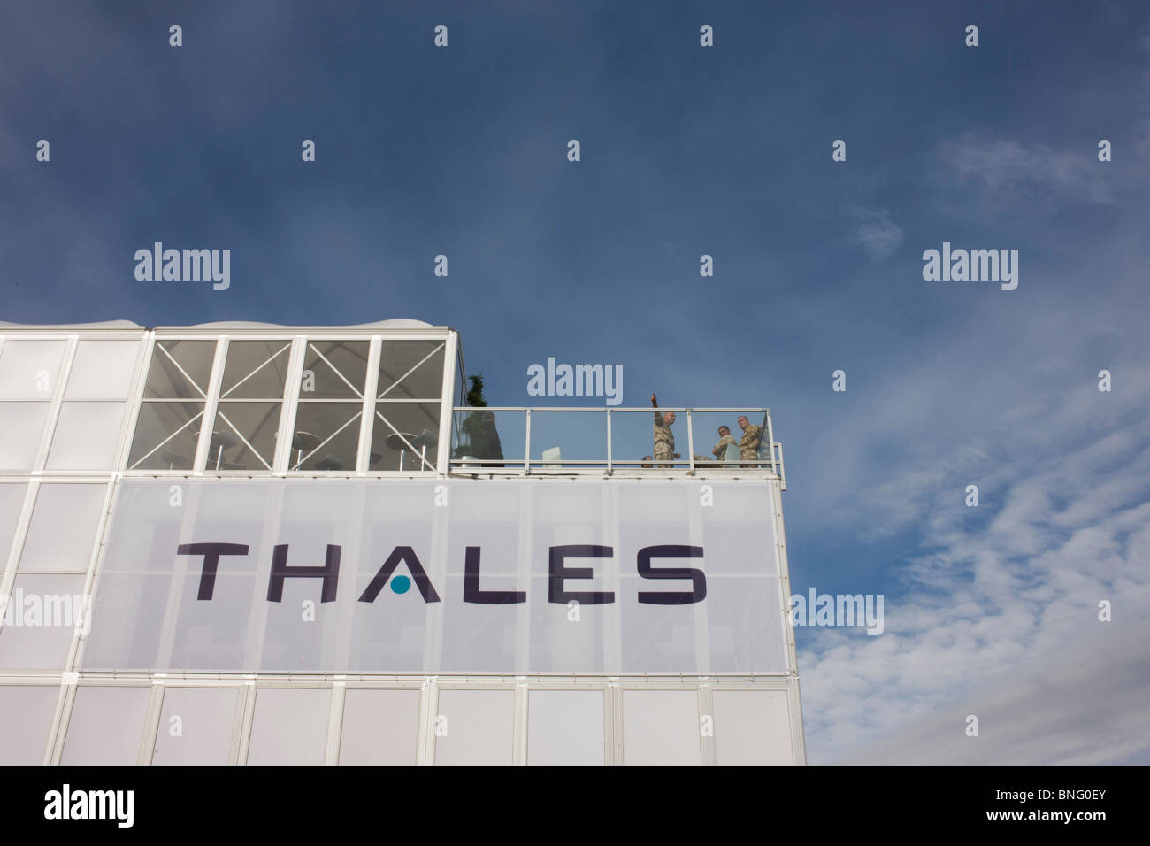 Military guests of Aerospace manufacturer Thales hospitality chalet at the Farnborough Airshow. - Stock Image