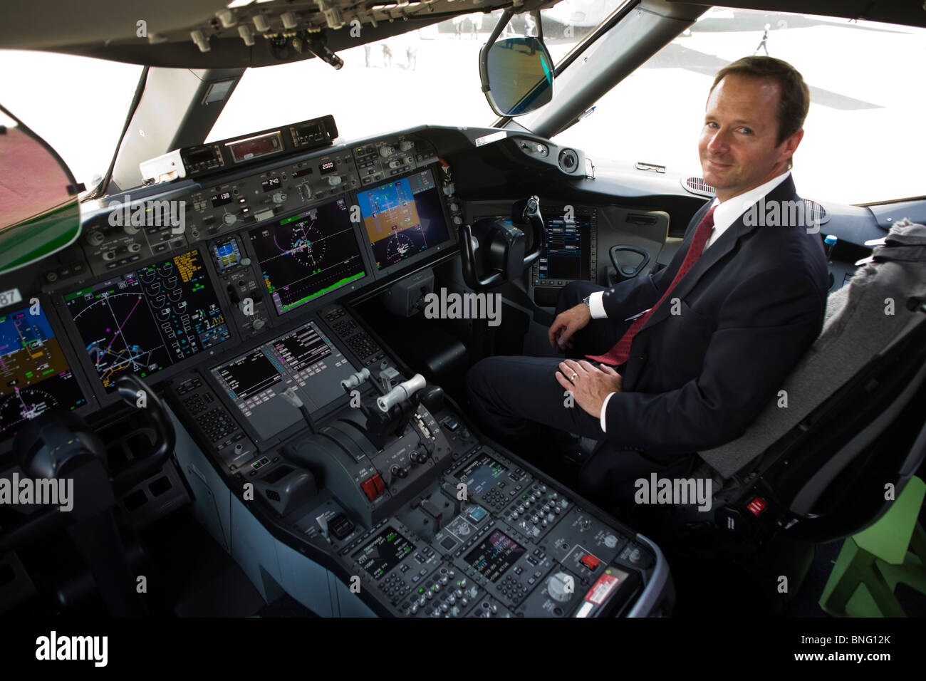 Boeing pilot portrait with LCD screens inside glass cockpit of company 787 Dreamliner - Stock Image