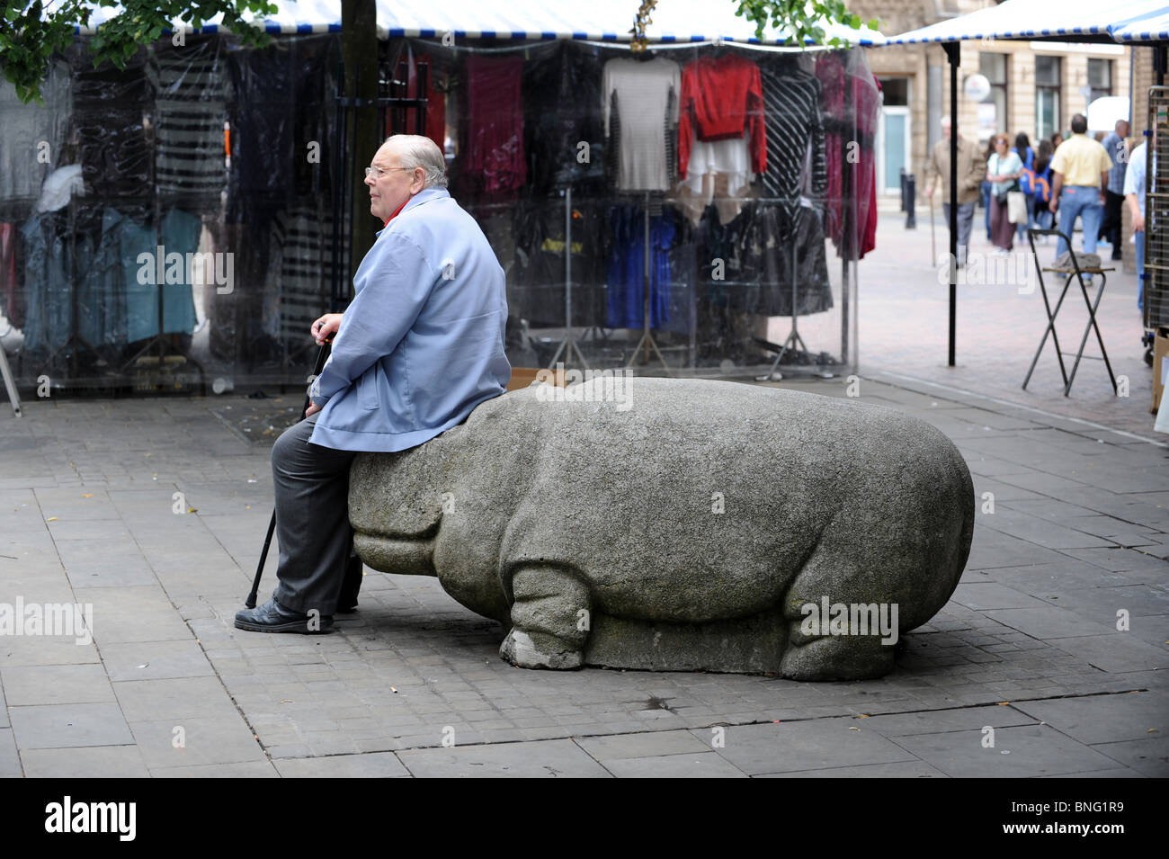 Elderly man taking a rest on a hippo seat Walsall West Midlands England Uk - Stock Image