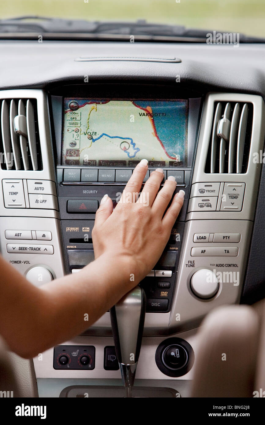 woman in car with navigation system - Stock Image