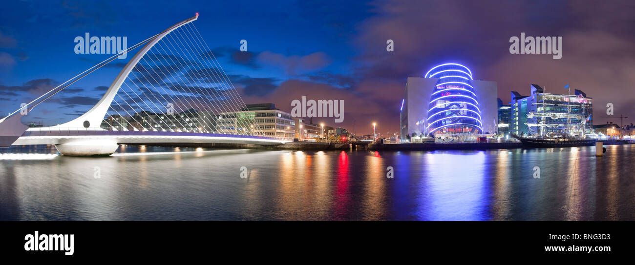 Night time panorama of the Samuel Beckett Bridge and the Convention Center in Dublin, Ireland. - Stock Image