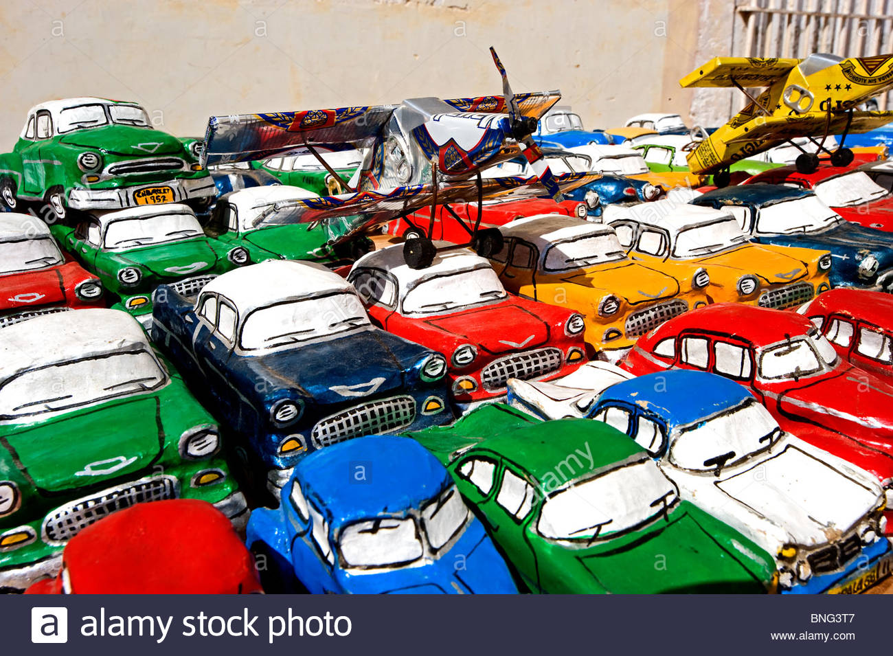 Street vendor selling tin made cars. Trinidad,Cuba - Stock Image