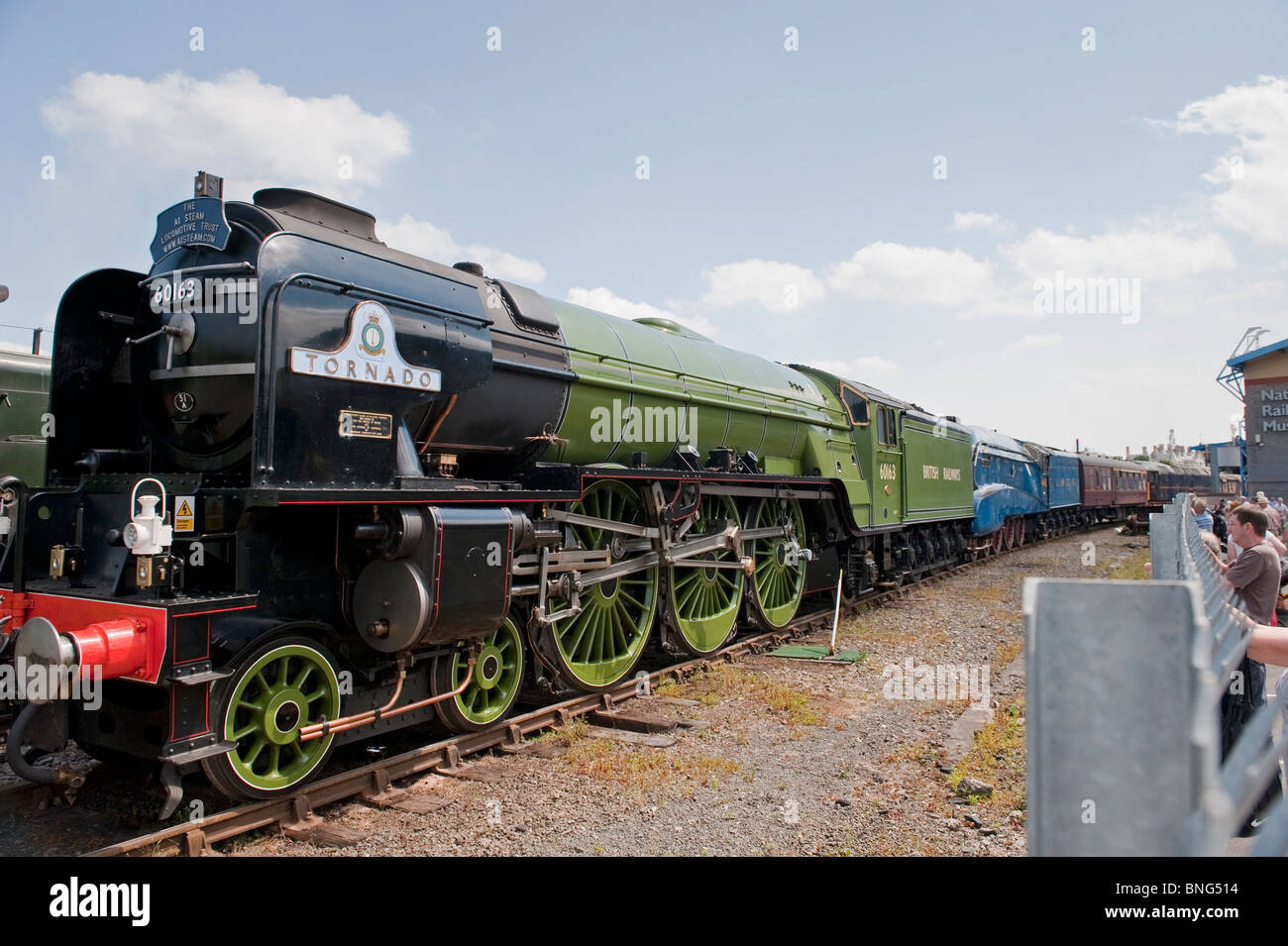 the newly built tornado steam train waits at the national railway museum york to pull