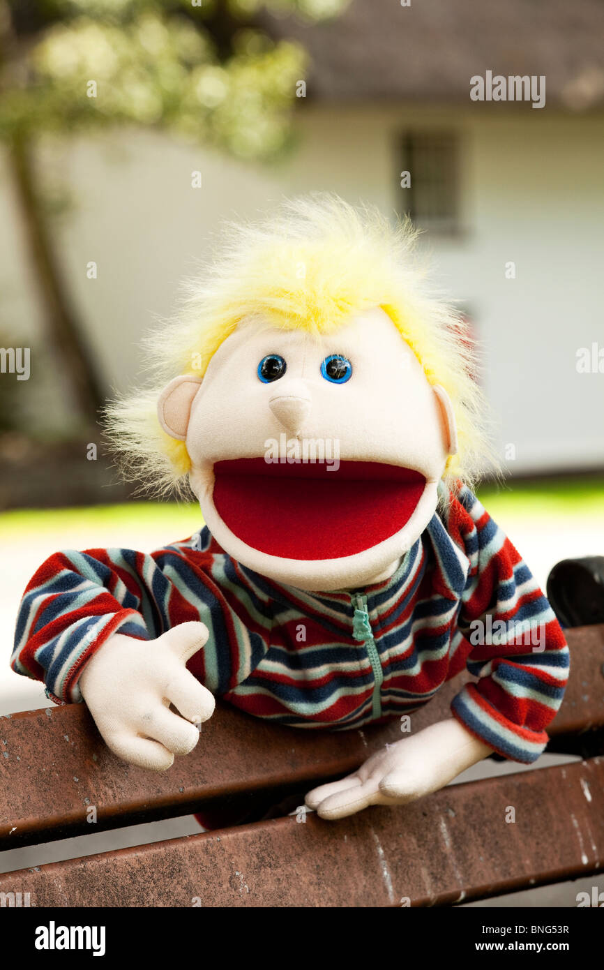 Dumbfounded spiky blond hair puppet. Stock Photo