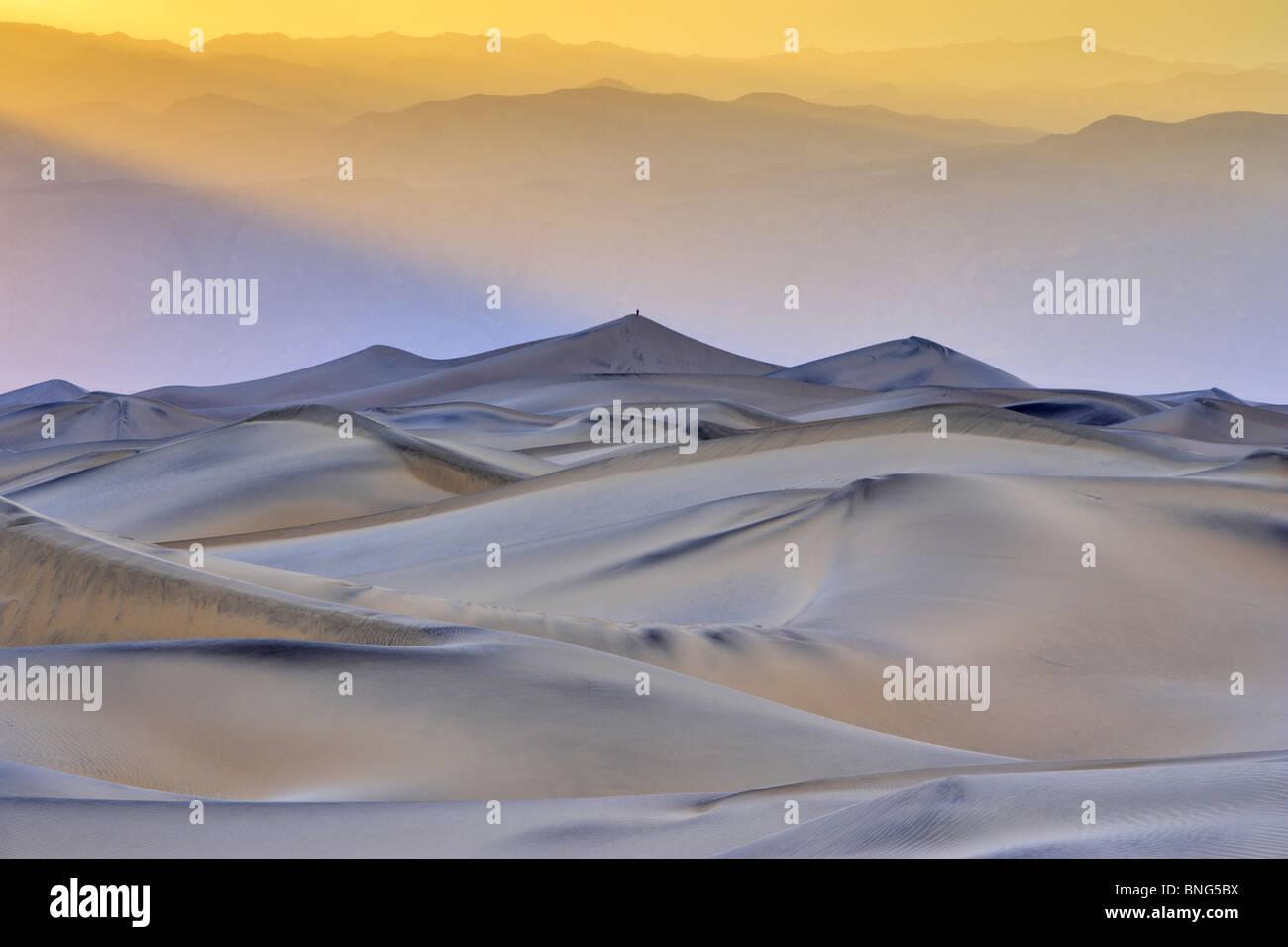 Sand dunes in a desert, Mesquite Flat Dunes, Death Valley, Panamint Range, California, USA - Stock Image