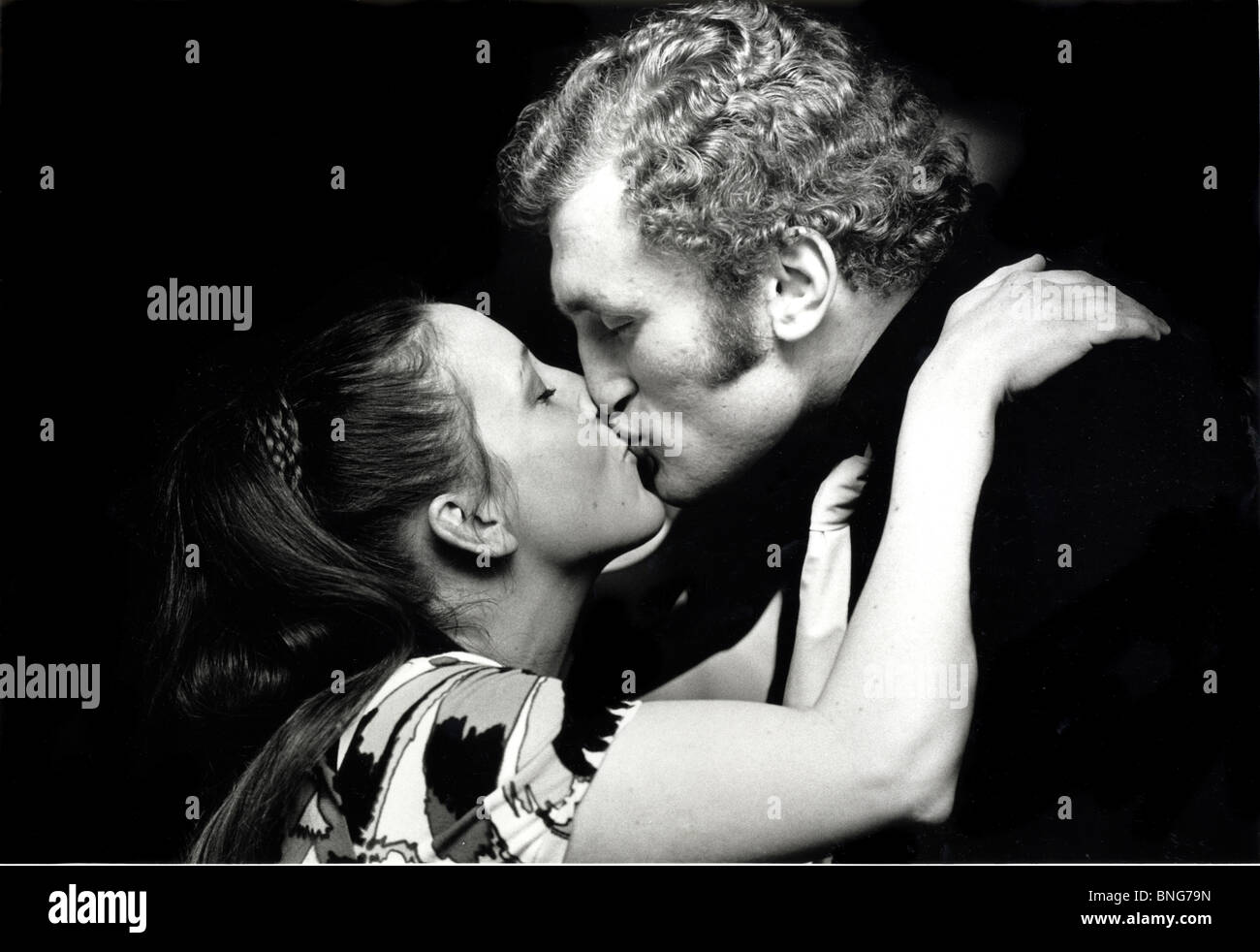 Joe Bugner the Hungarian born British heavyweight champion boxer, kissing his wife. - Stock Image