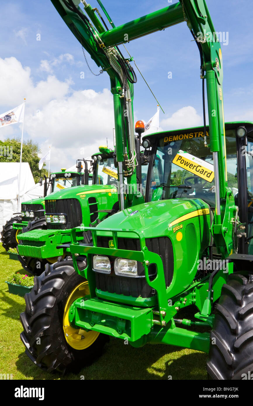 A range of John Deere tractors on display at an agricultural show in the village of Corbridge, Northumberland, England - Stock Image