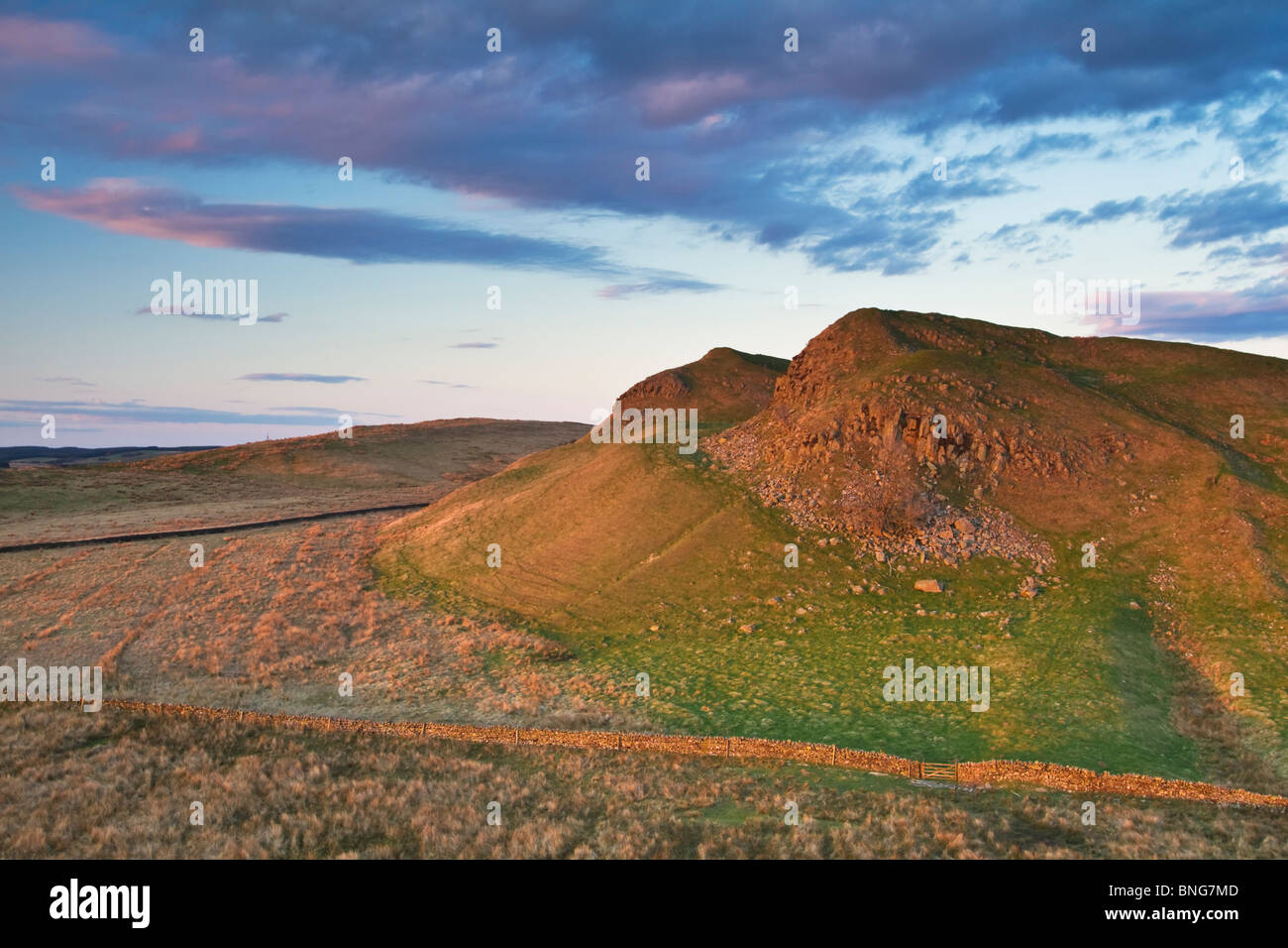 View of the crags of King Arthur's Well near Walltown and the village of Greenhead, Northumberland National - Stock Image