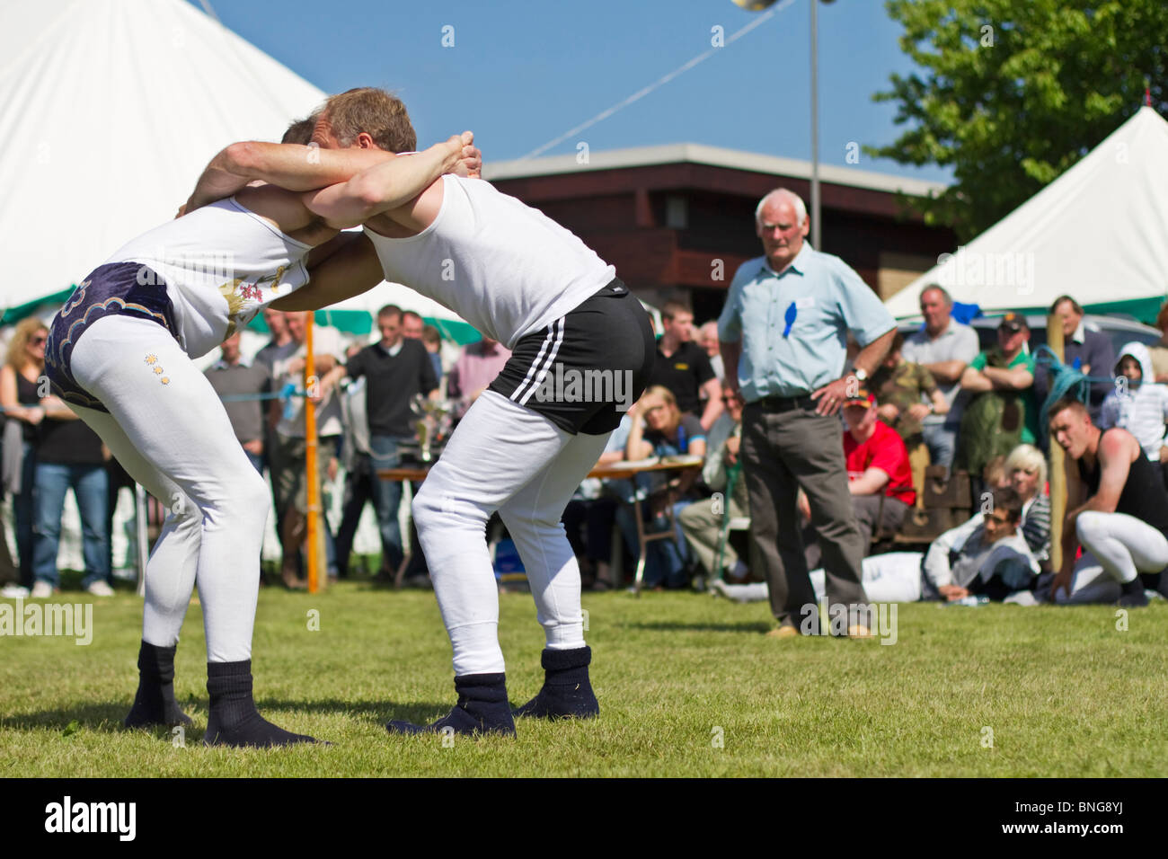 Young men engaged in 'Cumberland Wrestling' at the Northumberland County Show in Corbridge, England - Stock Image