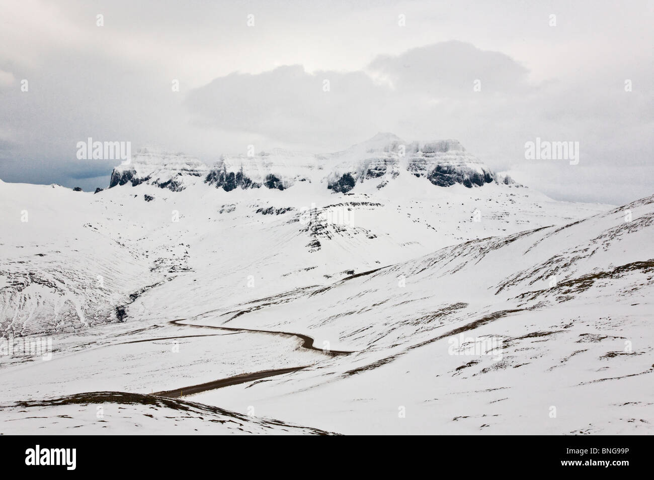 Mountain pass and Dyrfjoll mountain, East Iceland - Stock Image