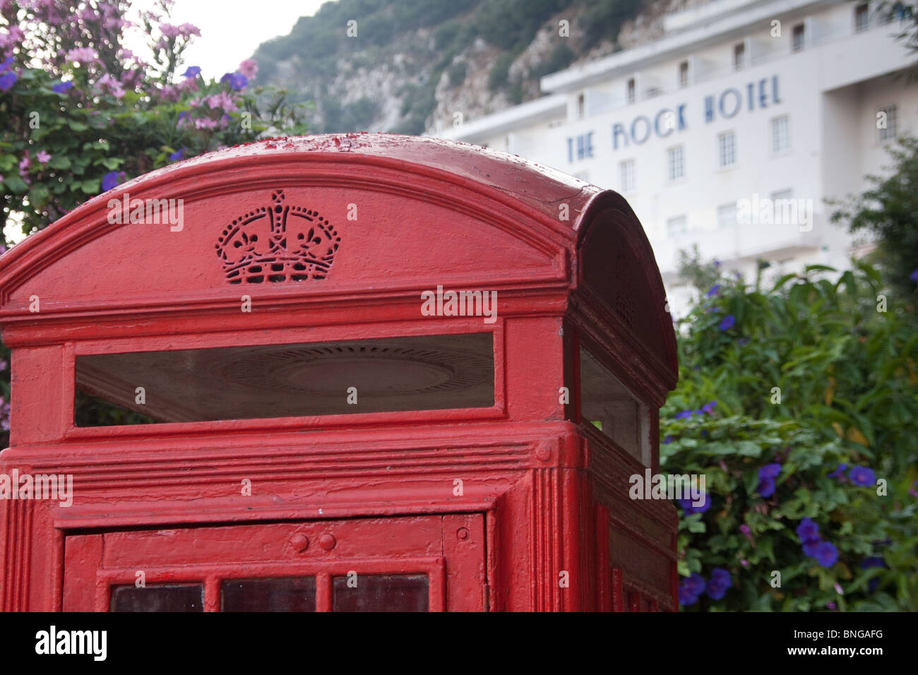 The Rock Hotel, Gibraltar with red British-style telephone box - Stock Image