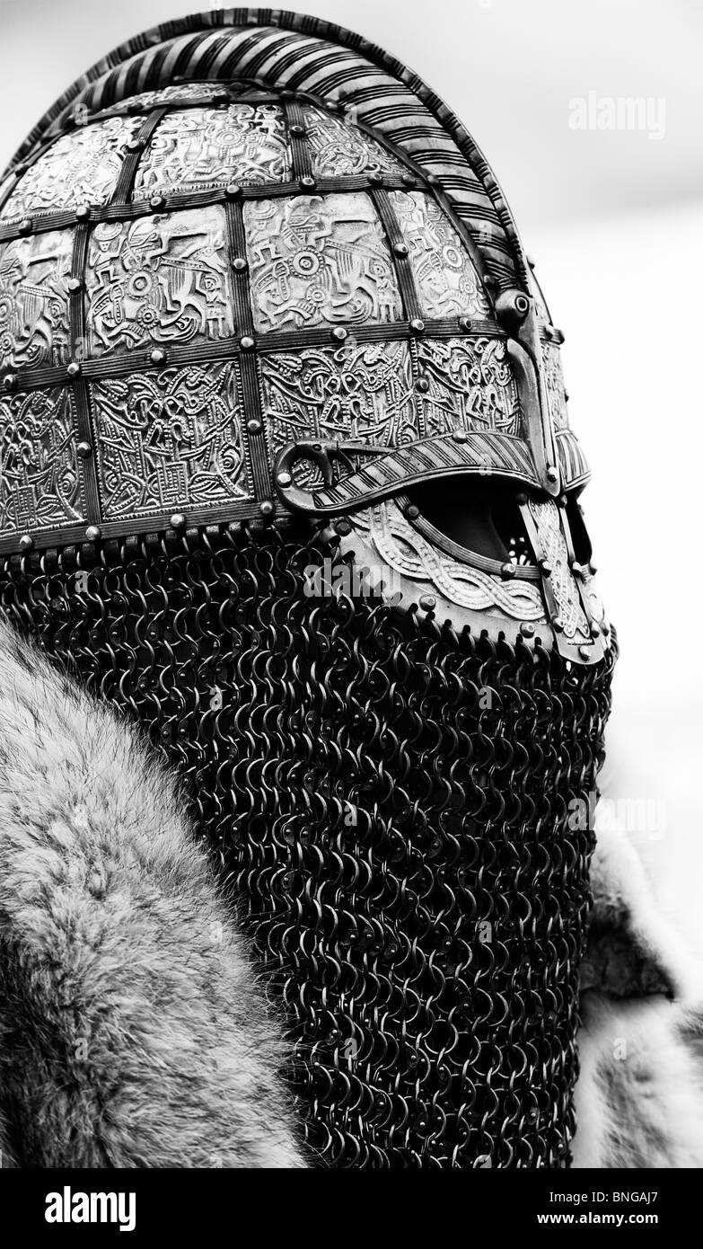 Anglo Saxon replica helmet worn by soldier. Monochrome - Stock Image
