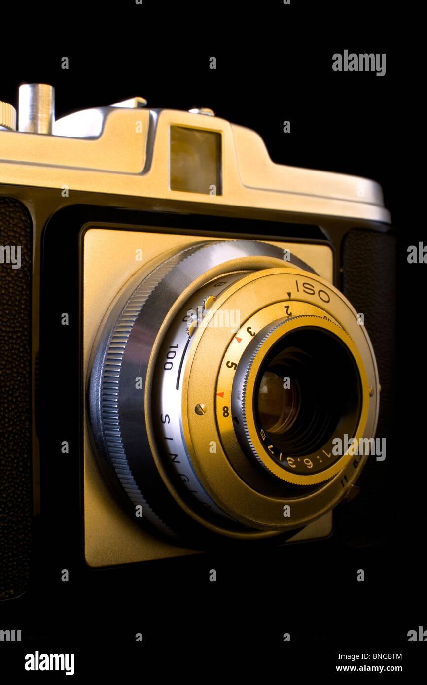 Old vintage rangefinder medium format photo camera - Stock Image
