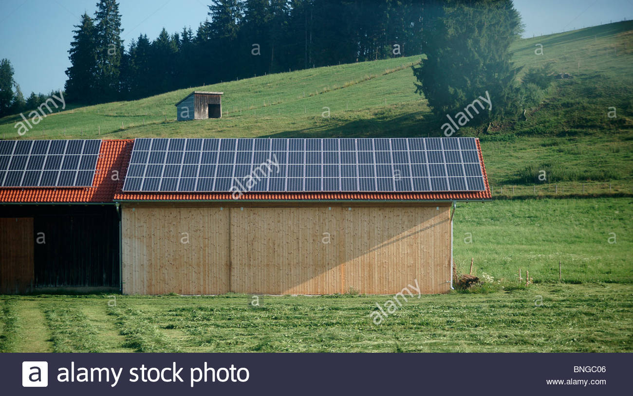Solar panels on the roof of a German farm building Bavaria Germany Stock Photo