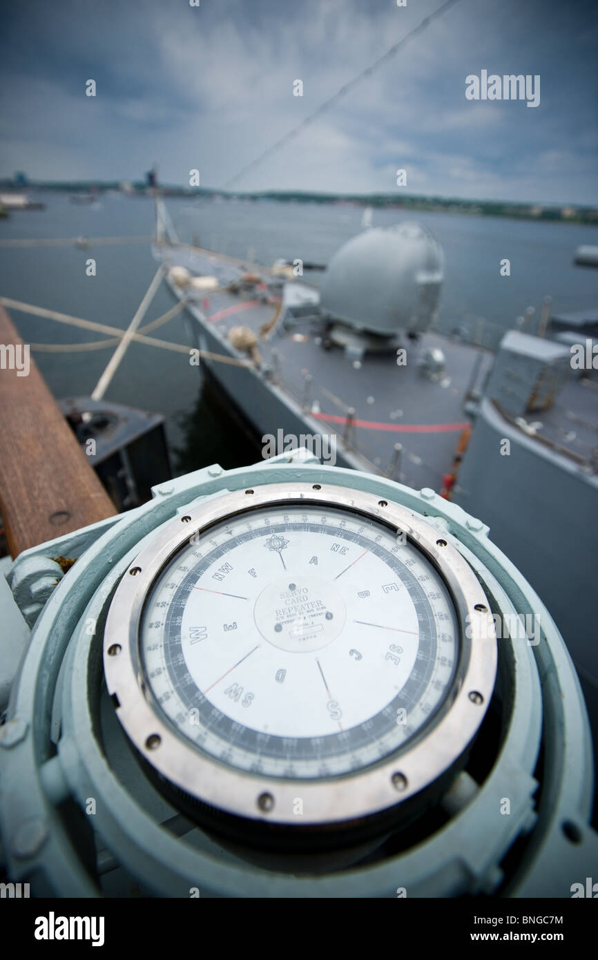 Compass repeater on the starboard bridge wing of Canadian Navy frigate HMCS TORONTO with Brazilian frigate in the - Stock Image