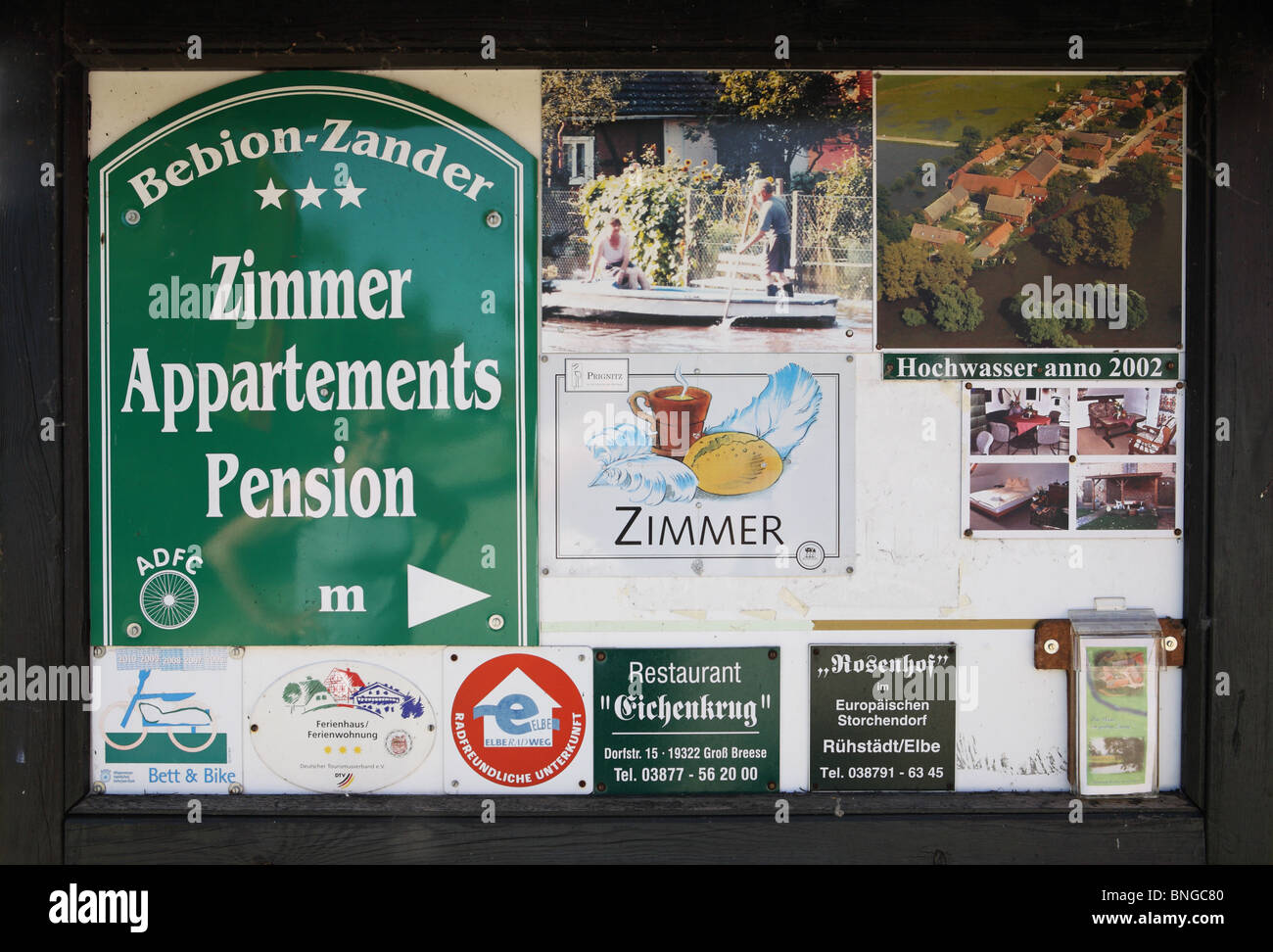A noticeboard in the German village of Bälow, advertising local B&B accommodation and hotels. - Stock Image