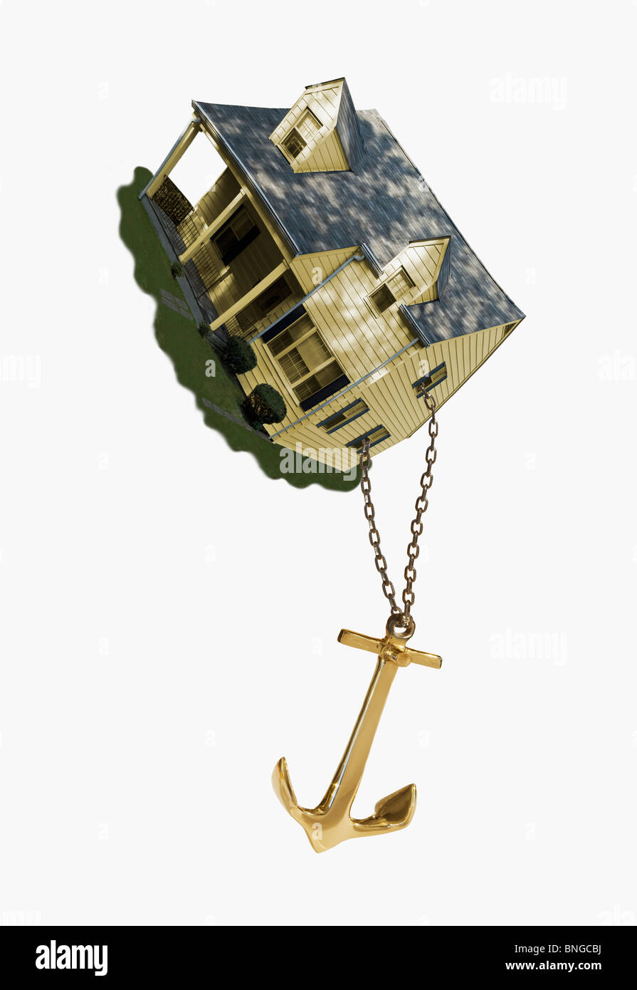 anchor chained to house - Stock Image