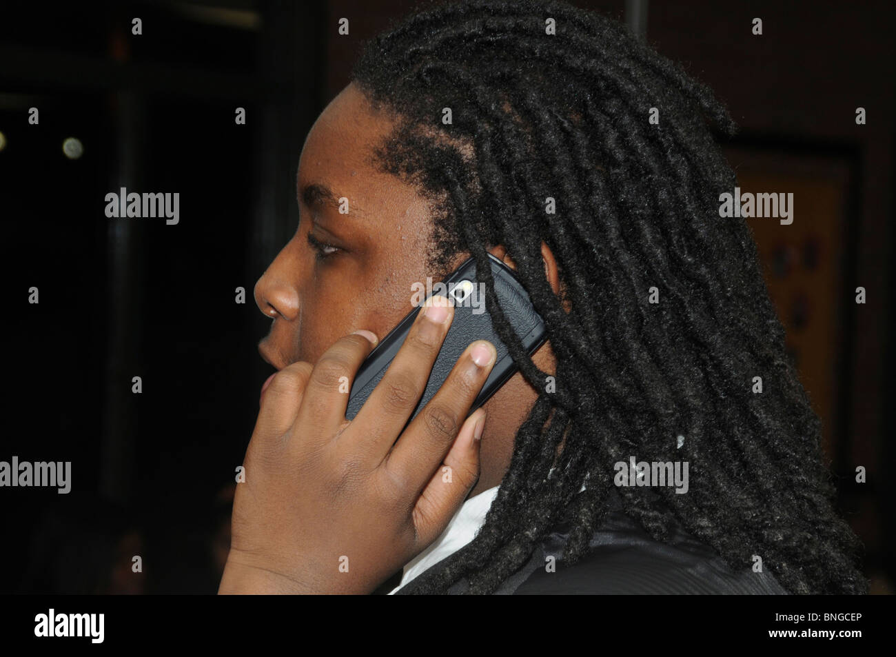 Teen talking on a cellphone, - Stock Image