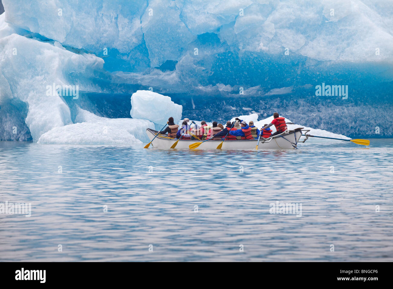 USA; Alaska; Juneau; Mendenhall Glacier  Tourist touring the glacier in a canoe - Stock Image