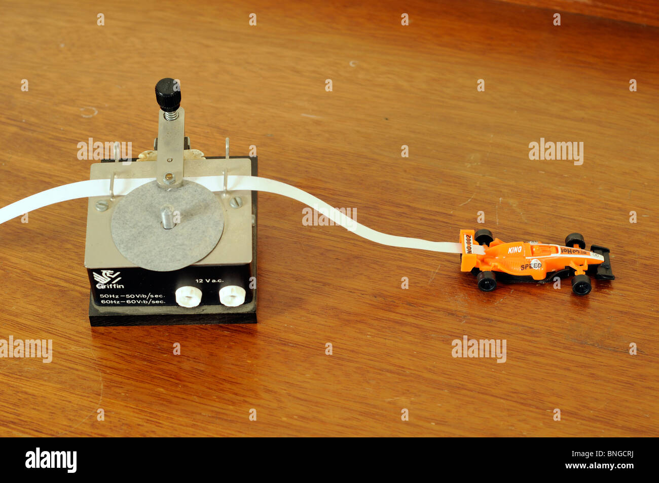 Ticker tape timer and model racing car. - Stock Image