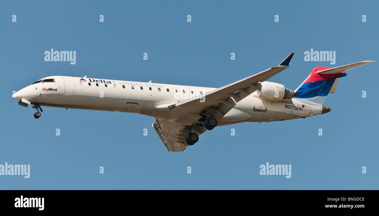 A Delta Connection (SkyWest Airlines) CRJ-702 regional passenger jet ...