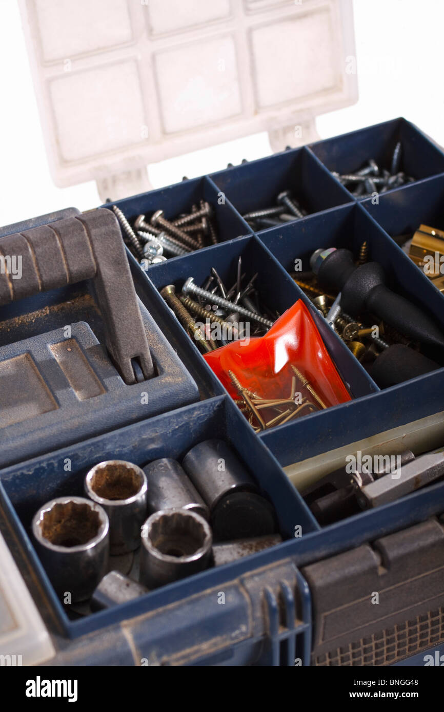 Toolbox with assorted fittings and fasteners. Isolated. - Stock Image