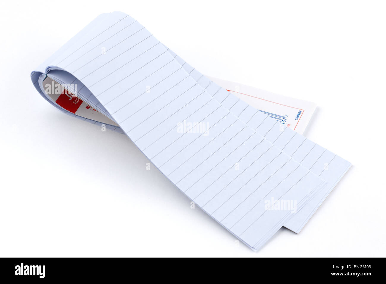 Ruled 50 sheet long folded paper Jotter pad - Stock Image