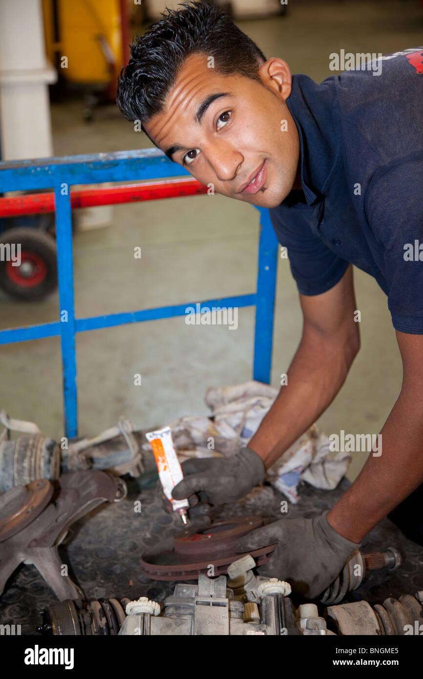 Looking up mechanic - Stock Image