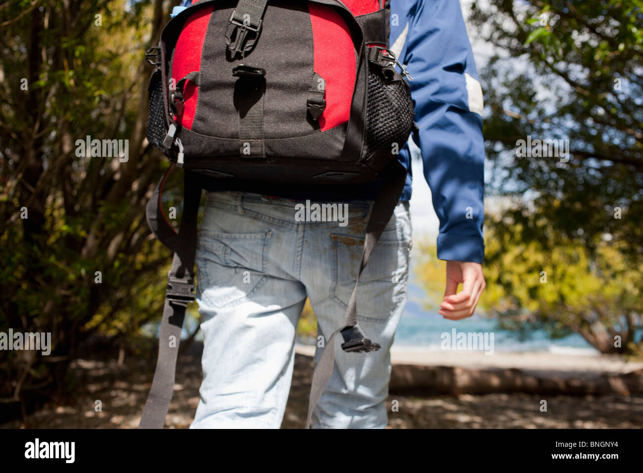 Traveller walking with a backpack - Stock Image