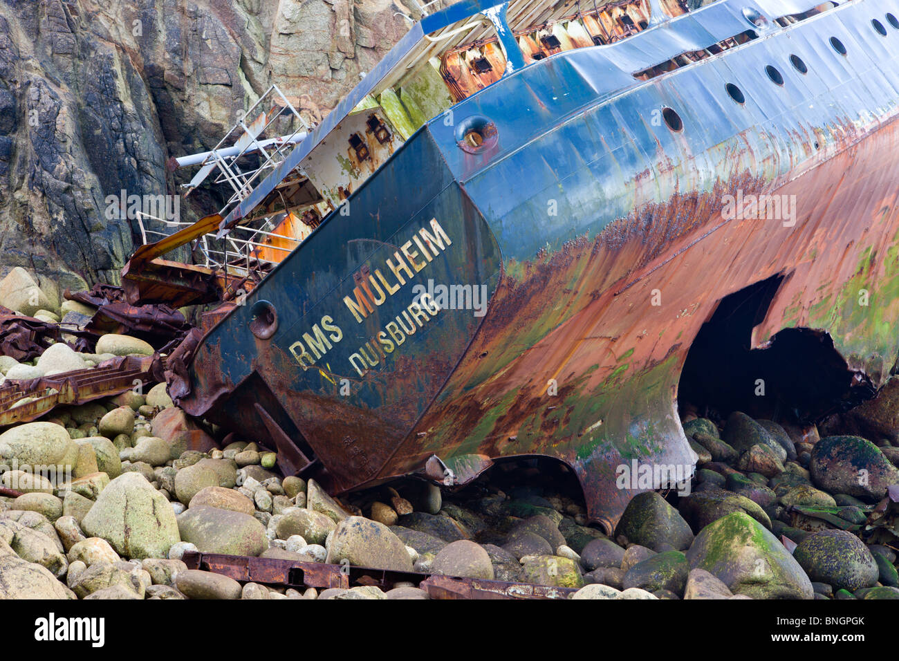 Wreckage of the shipwrecked ship the RMS Mulheim at the base of the cliffs near Land's End, Cornwall, England. - Stock Image