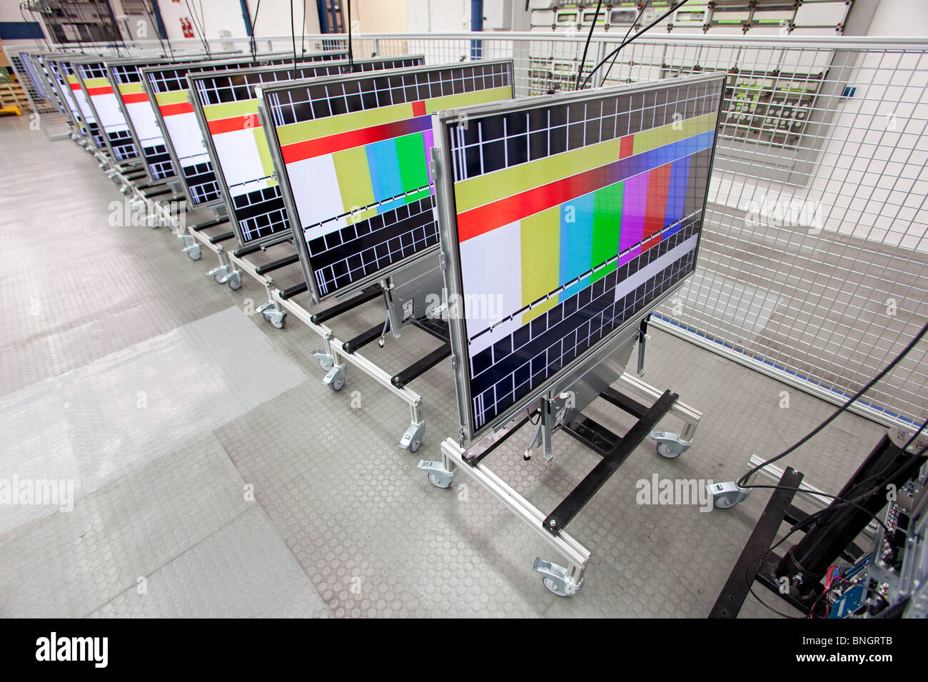 Loewe AG: production of high class television sets; quality test of LCD flat screens - Stock Image