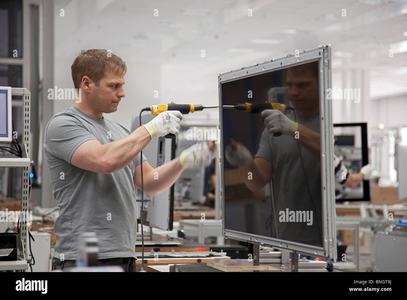 Production of high-value flat screen LCD television sets by Loewe AG, Kronach, Germany - Stock Image