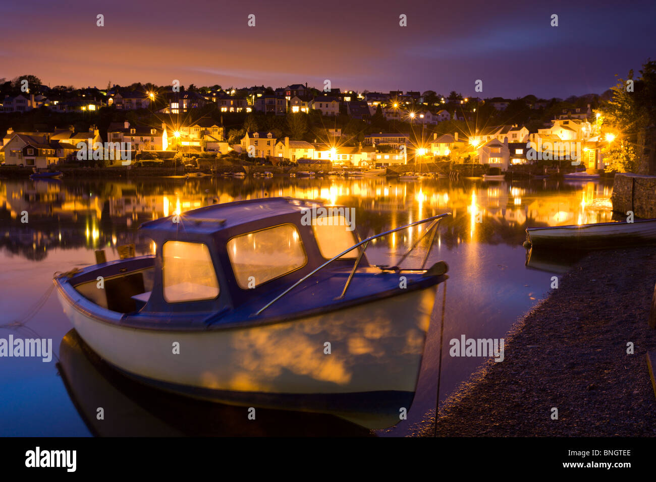 Evening lights from Newton Ferrers on the Yealm Estuary, South Hams, Devon. - Stock Image