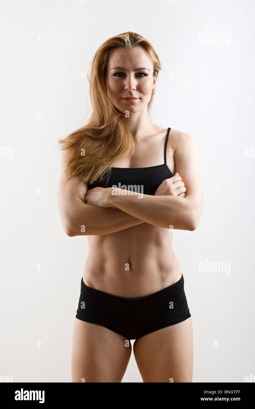 Female athletic trainer ready for workout - Stock Image