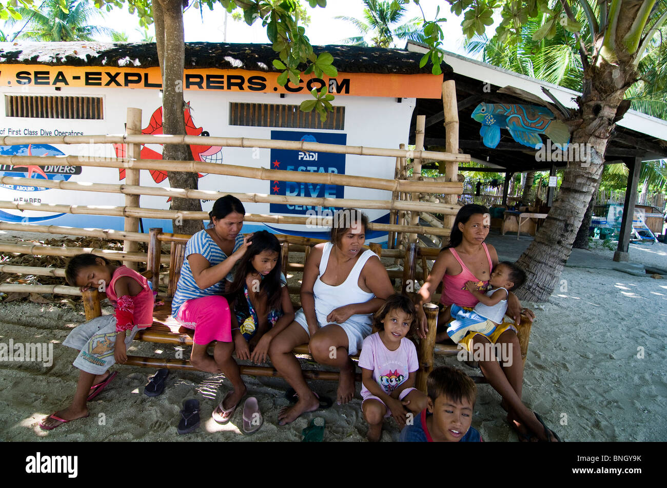 A group of Filipinos near their home in their village on a small island near Cebu island. - Stock Image