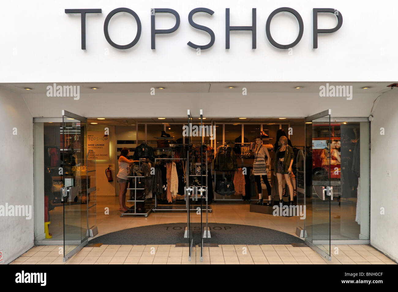 Topshop part of Arcadia business Group a British fashion retail clothing store front entrance doors & interior The Stock Photo