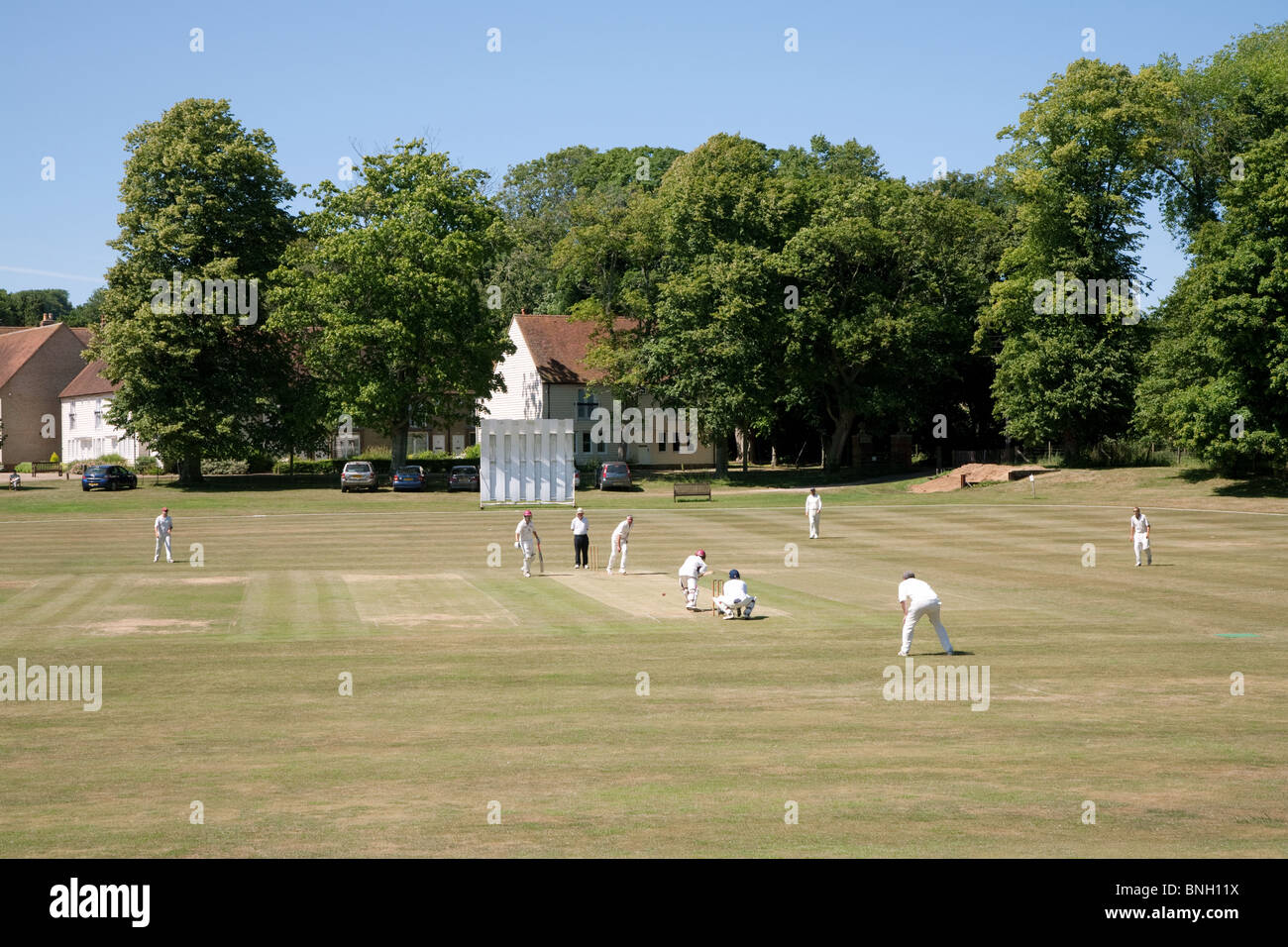 A weekend game of cricket in the english village of Lyminge, Kent, UK - Stock Image