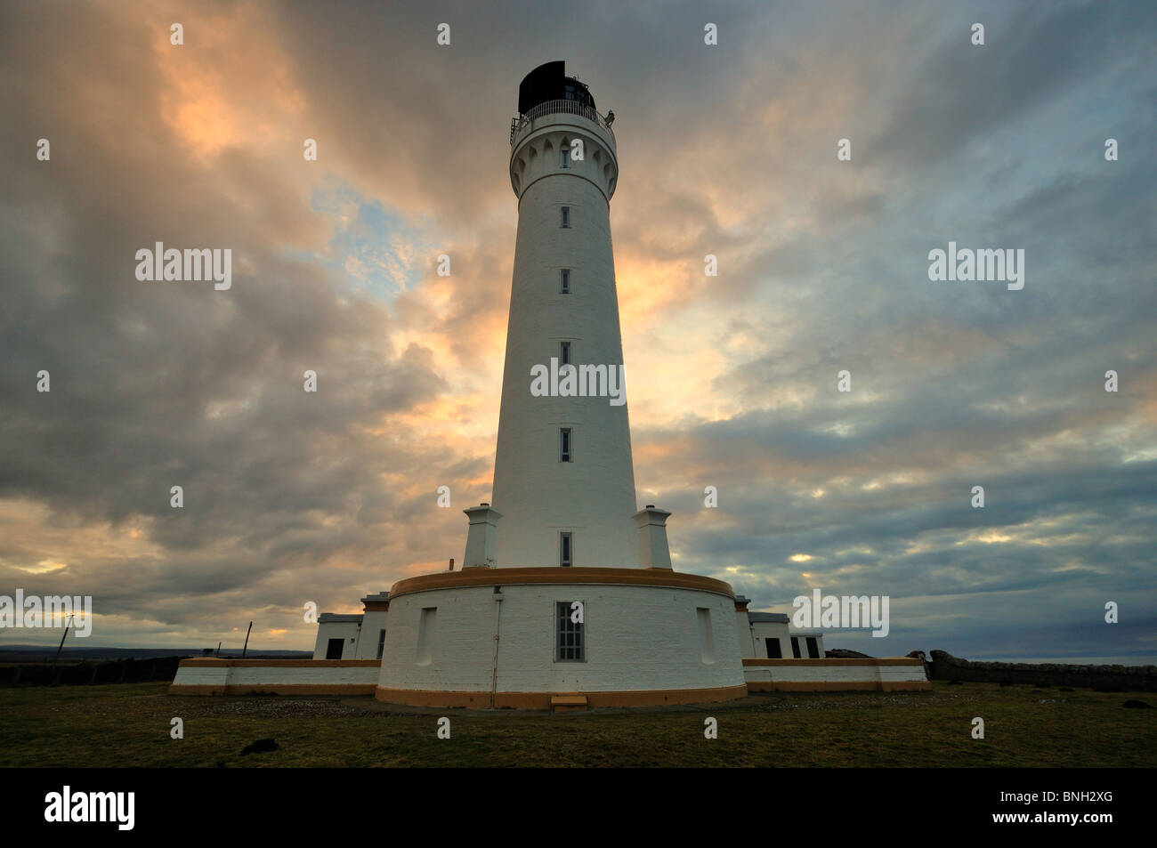 Covesea Skerries Lighthouse at sunset, Lossiemouth, Morayshire, Scotland - Stock Image