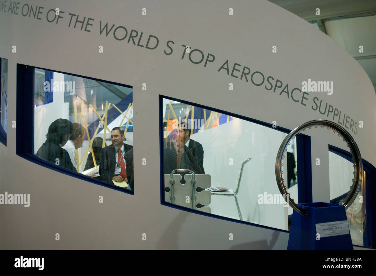 Aerospace meeting between an unknown manufacturer and potential buyers of their products at England's Farnborough - Stock Image