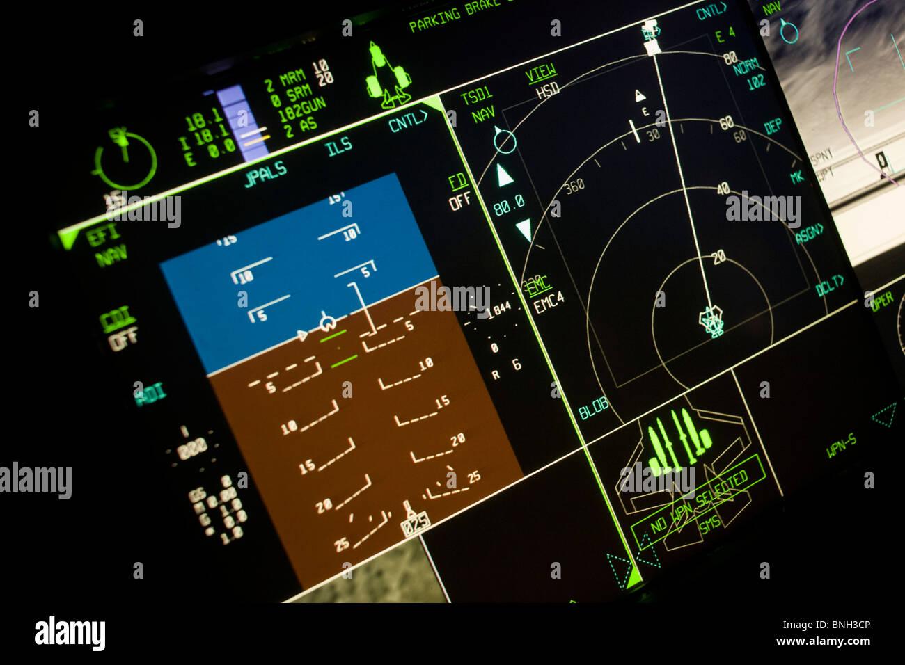 Glowing simulator cockpit instrumentation of a Lockheed Martin F-35 Lightning II stealth fighter. - Stock Image