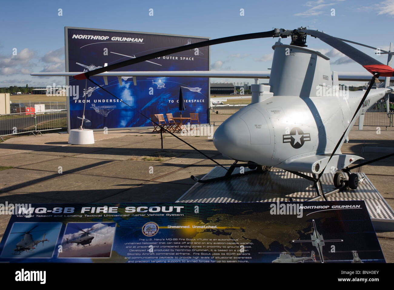 A Northrup Grumman US Air Force MQ-8B Fire Scout surveillance UAV helicopter exhibited at the Farnborough Airshow. - Stock Image