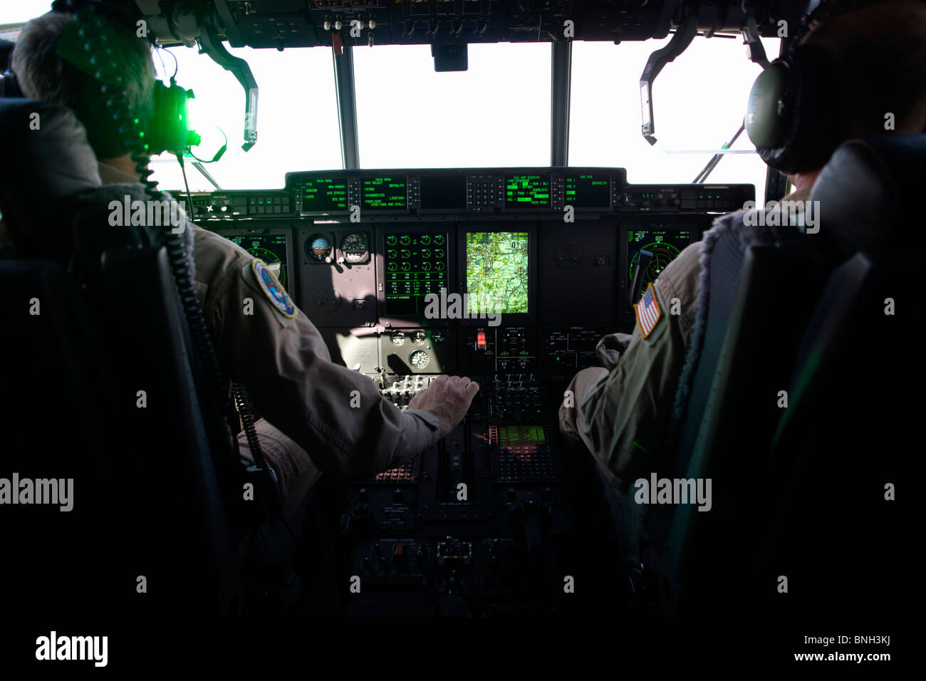 Green light from the Head-Up Display (HUD) in the cockpit of a Lockheed Martin-built C-130J Super Hercules airlifter. - Stock Image