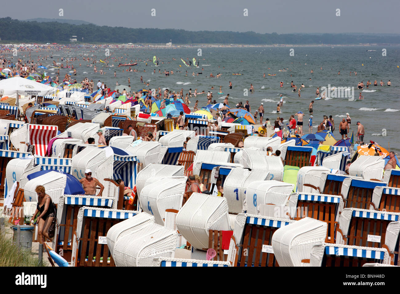 Seaside resort Binz on the island of Ruegen, northeast Germany at the baltic sea. Summertime, full beaches. - Stock Image