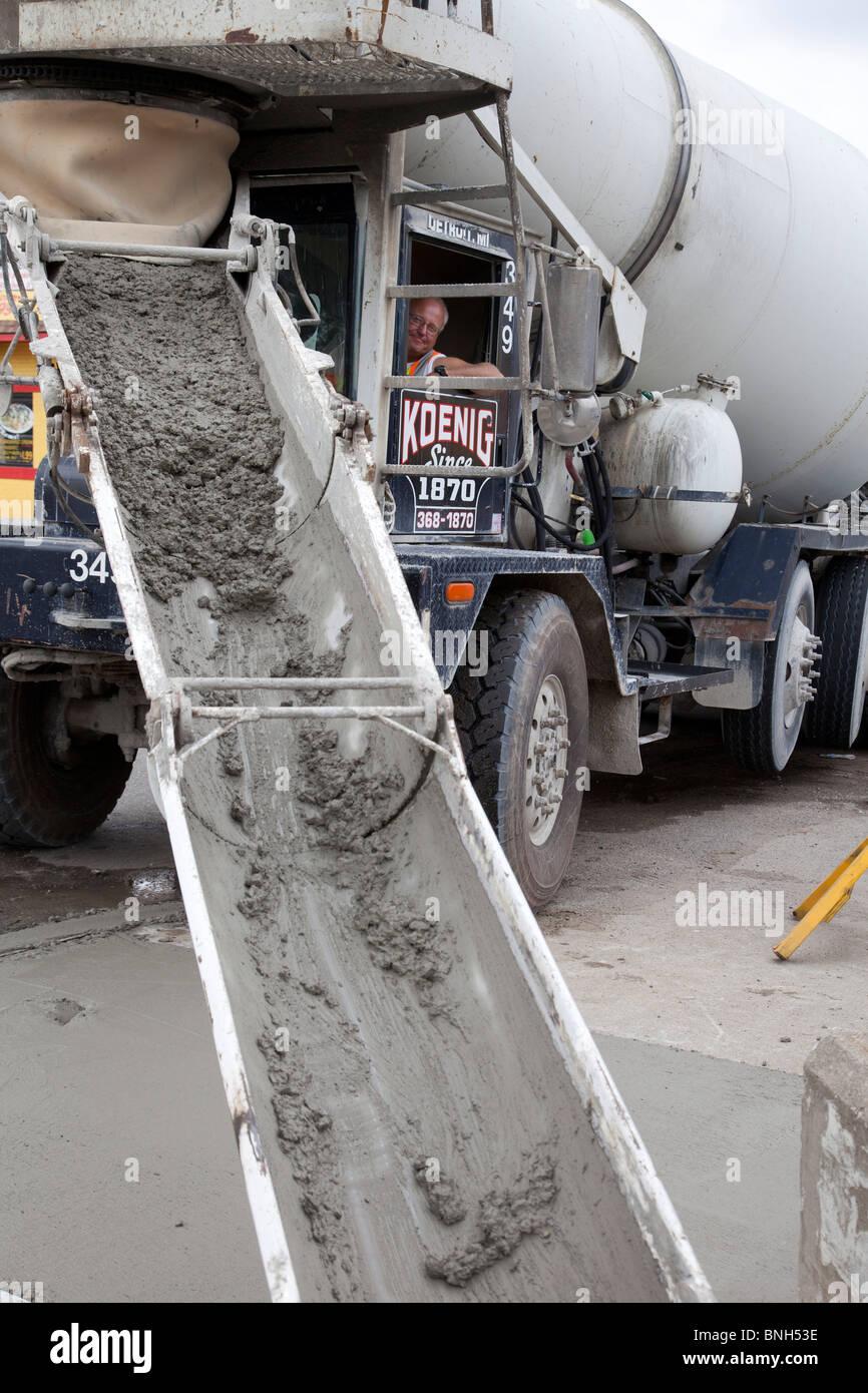 Detroit, Michigan - Driver of cement mixer unloads his cargo. - Stock Image