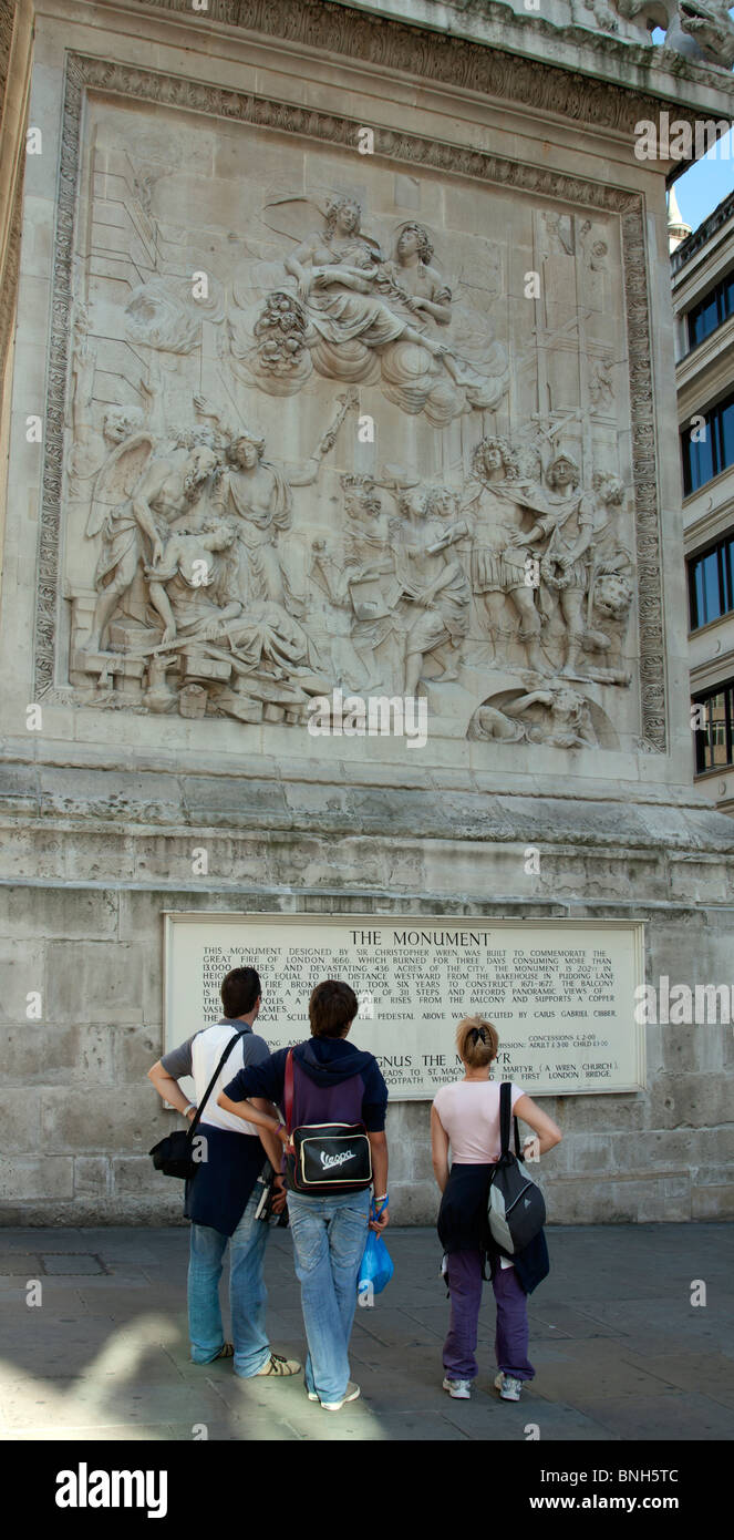 Tourists - The Monument to great fire of London (west panel) - City of London - Stock Image
