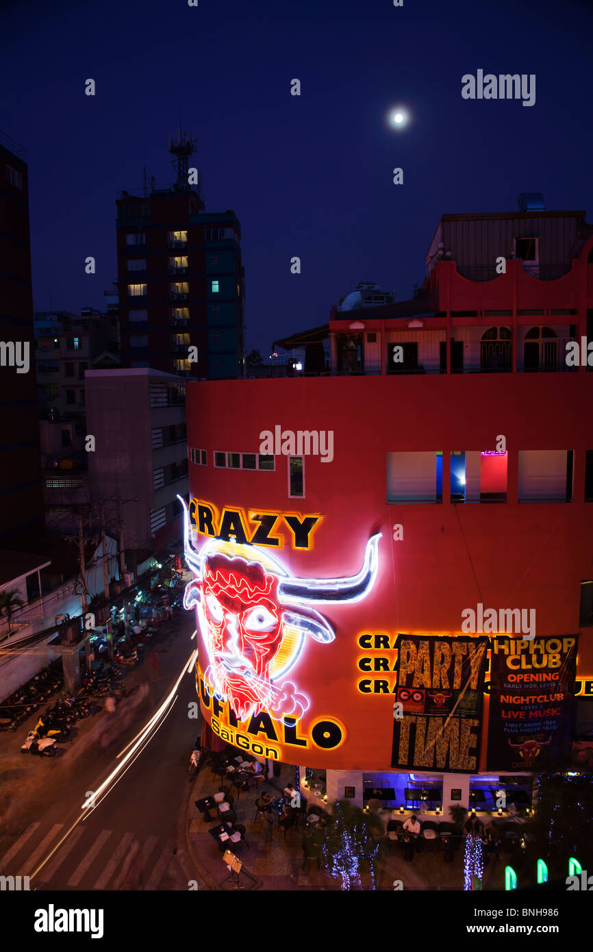 Street scene with view over Nightclub bar hot spot Crazy Buffalo Pham Ngu Lao Saigon Ho Chi Minh City Vietnam by - Stock Image
