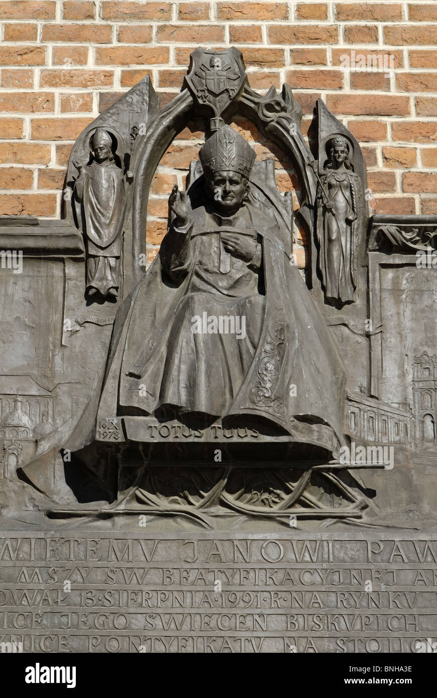 Commemorative table pope Johannes Paul II Krakow Cracow Poland Europe old Old Town building sculpture statue monument - Stock Image