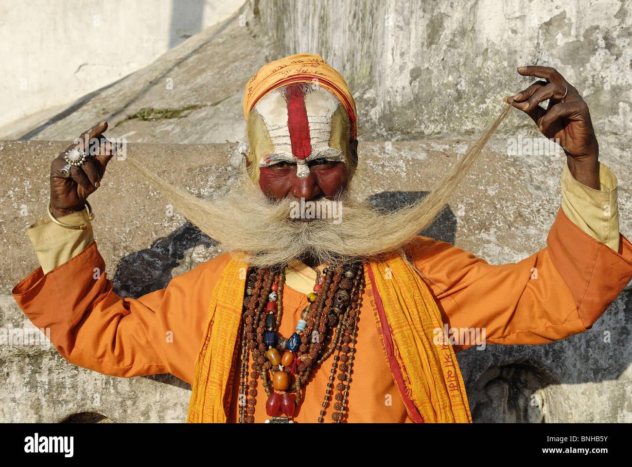 Sadhu holy man Pashupatinath Katmandu Nepal Himalayas Asia Asian asceticism ascetic ascetically beard whiskers painted - Stock Image